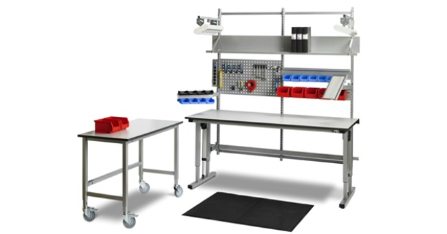 Electrically powered adjustable height workbench